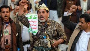 Cartello con lo slogan del movimento Houthi